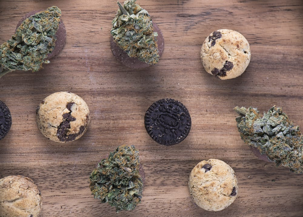 marijuana buds next to edible cookies