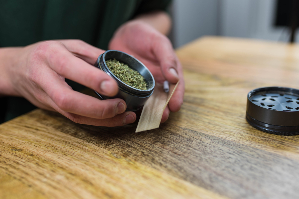 ground flower in a grinder for a joint