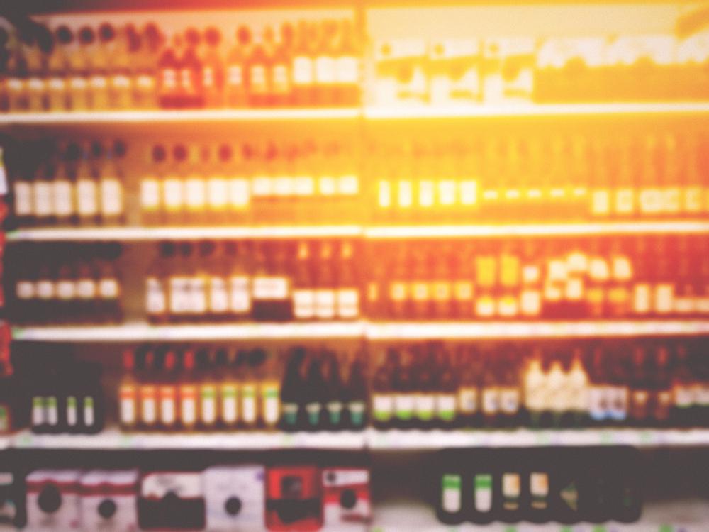 blurred full alcohol store shelf