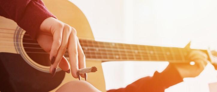 playing guitar smoking joint