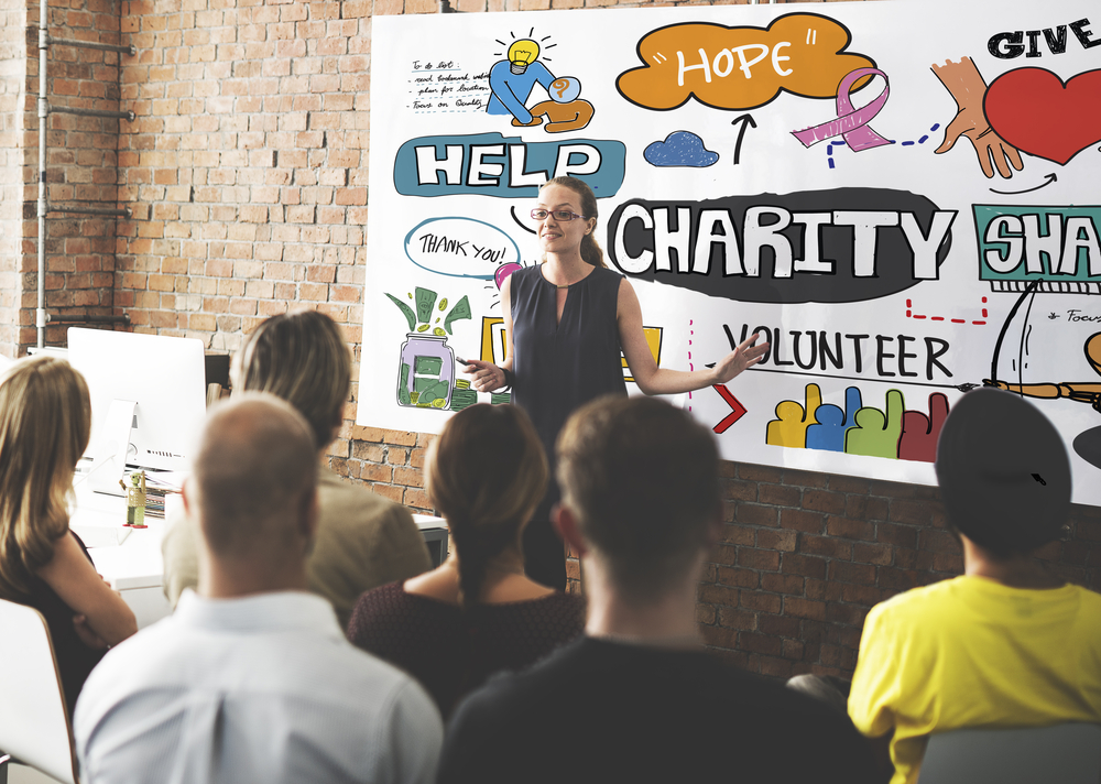 WOman gives presentation on charity
