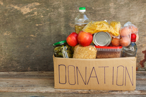 A cardboard box with donations